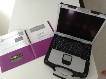 Panasonic Toughbook with computer literacy training materials provided by BDDP.
