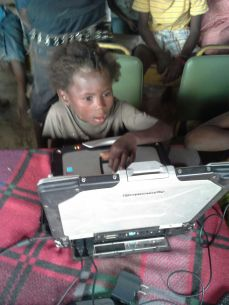 A Geodis-donated Toughbook in use in Grande Saline, Haiti