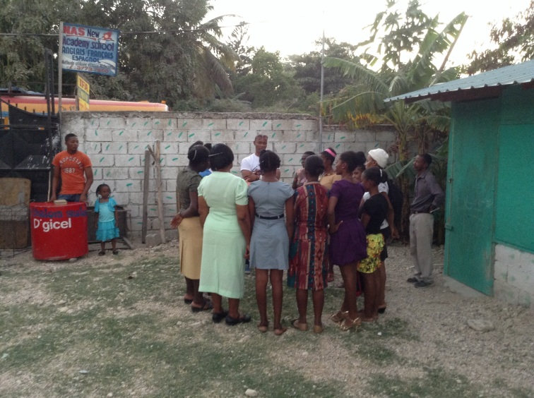 Gina talks to the sewing school students.