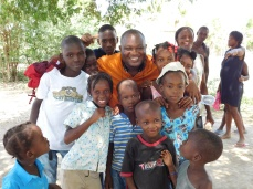 Dr. Robinson hangs out with some local children.