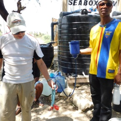 Tom and JJ try to repair a LifeStraw water filtration system provided by the 2014 Health for Haiti class.
