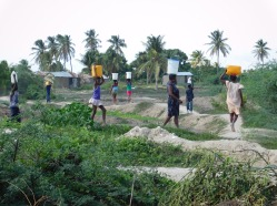 Members of the community take water home.