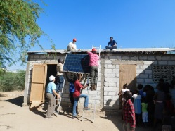 Team solar puts the panels in place.