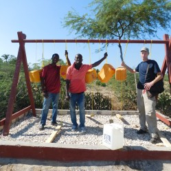 Joel (center) will fill the water jugs and take care of the tippy-tap.