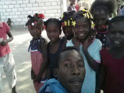 Schneider with some of the children.