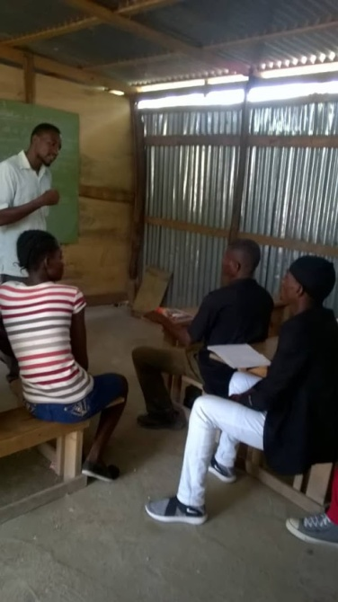 Computer literacy class for adults in Grande Saline, Haiti.
