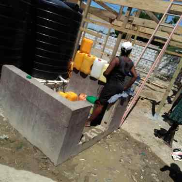 People come to the water system all day long to fill containers with safe drinking water.